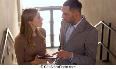 businesswoman and businessman with tablet pc - business...