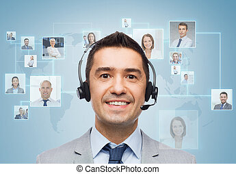 smiling businessman in headset - business, people,...