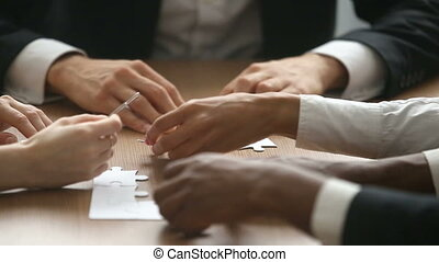 Business people trying to connect jigsaw puzzle, bad teamwork concept