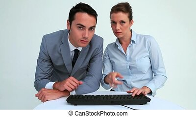 Business people typing on a keyboard