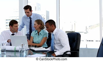 Business people using a laptop duri