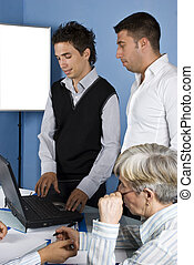 Business people using a laptop - Two business man using...