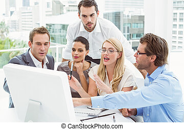 Business people using laptop in mee