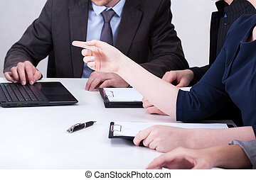 Business people using notebook