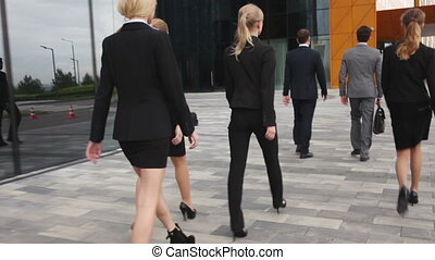 Business people walk outdoors