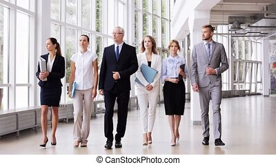 business people walking along office building - people, work...