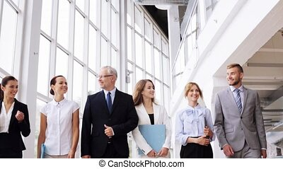 business people walking along office building 4 - people,...