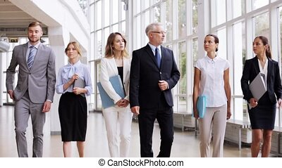 business people walking along office building 5