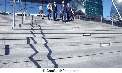 Business people walking down stairs