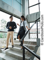 business people walking on stairs in the office