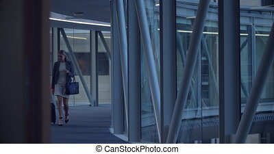 Business people walking together in the corridor at office ...