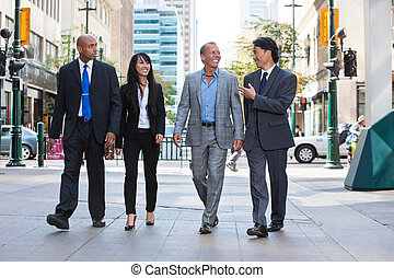 Business people walking together on street - Group of happy...