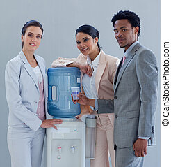 Business people with a water cooler in office