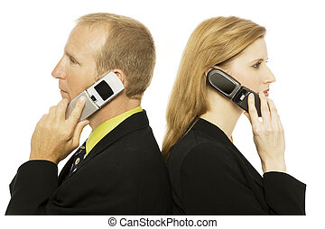 Business people with cell phones - Two business people use...
