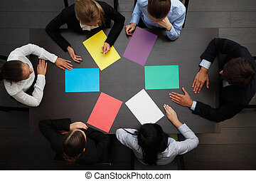 business people with colored paper