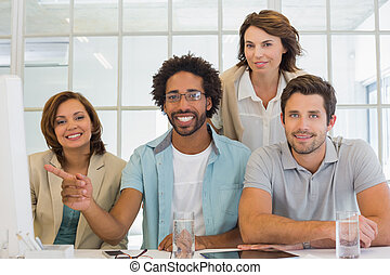 Business people with computer at office desk