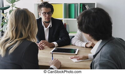 Business people With Digital Tablet Having Meeting In Office