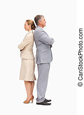 Business people with folded arms back to back