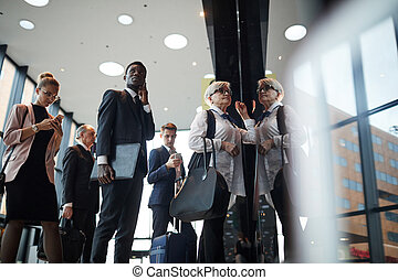 Business people with luggage at the airport