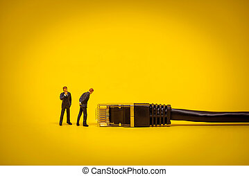 Business people with network cable. Technology concept