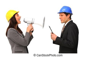 Business people with safety helmets and megaphone