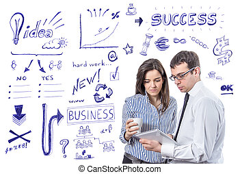 Business people with tablet over success symbols