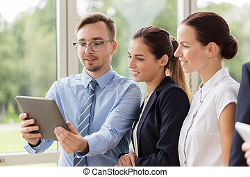 business people with tablet pc computer at office