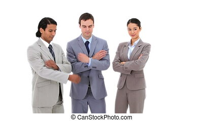 Business people with their arms crossed against a white...