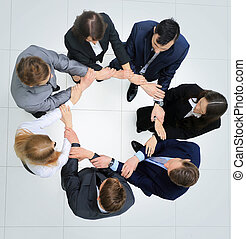 business people with their hands together in a circle - Top...