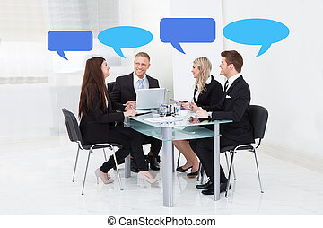 Business People With Thought Bubbles In Board Room