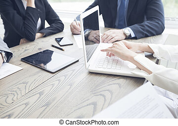 Business people work with documents and computers