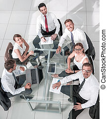 Business People Working Around a Conference Table