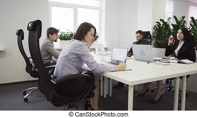 Business people working at a table in the office