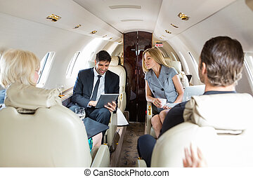 Business People Working In Private Jet
