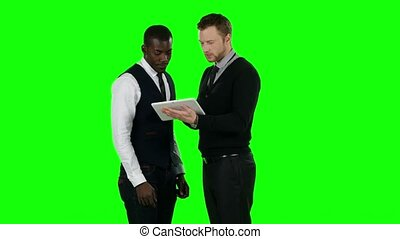 Business people working on a laptop. Green screen
