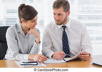 Business people working on documents