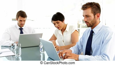 Business people working on laptops