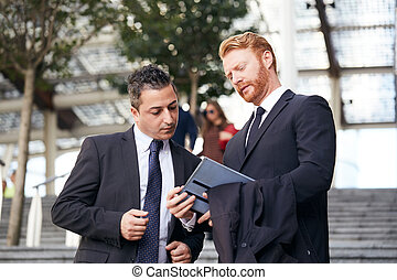 business people working outside office building