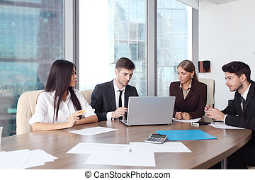 Business people working together at a meeting