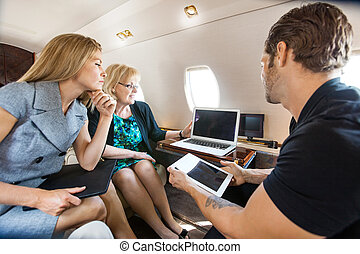 Business People Working Together In Private Jet - Business...
