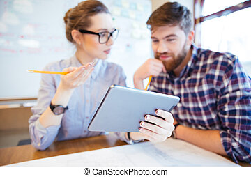 Business people working with tablet computer