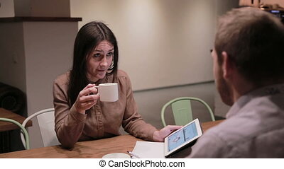 Business people working with tablet in cafe