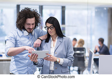 Business People Working With Tablet in startup office
