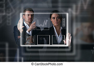 Business people working with virtual display