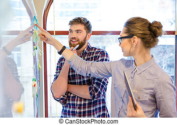 Business people working with whiteboard