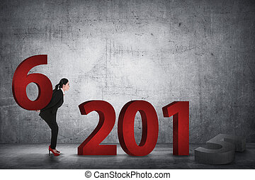 Business person changing 2015 number with 2016