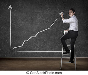 Business person drawing chart on the board