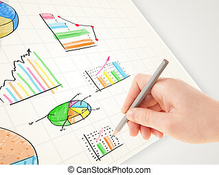 Business person drawing colorful graphs and icons on paper