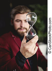 Business person holding a hourglass