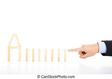 business person ready to push dominoes in a row